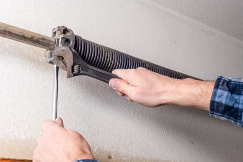 Can I replace my own garage door spring